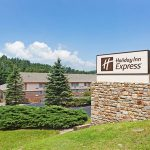 Holiday Inn Express Blowing Rock South with sign at daylight