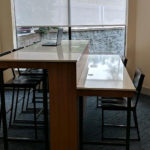 business center high top table with laptop