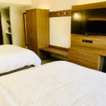 guest room with two queen beds and deluxe in-room amenities